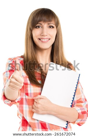 Young beautiful woman with blank notebook show thumb up. Student girl isolated on white background - stock photo