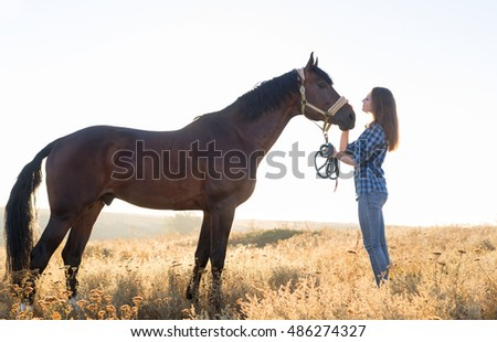 Young Beautiful Woman With Brown Horse Outdoors, Casual Girl Hold Bridle Nature Background