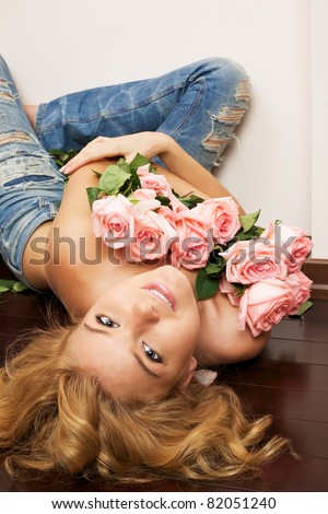 Young beautiful woman with bunch of roses - stock photo