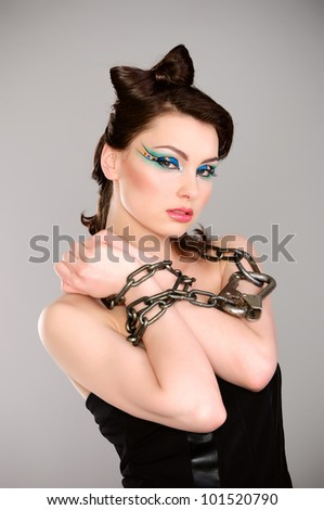 young beautiful woman with chain and makeup studio shot - stock photo
