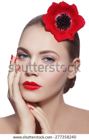 Young beautiful woman with clean make-up, red lips, fancy manicure and red flower in her hand over white background - stock photo