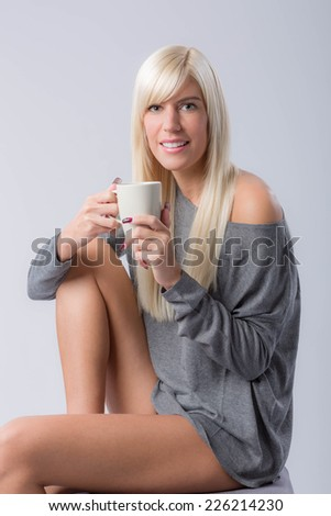 young beautiful woman with coffee cup