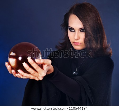 Young beautiful woman with crystal ball. - stock photo