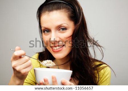 young beautiful woman with cup of muesli