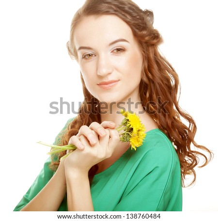 young beautiful woman with dandelion bouquet
