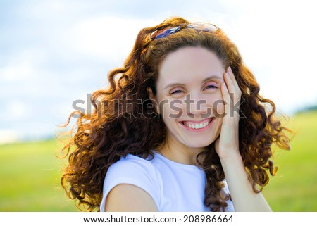young beautiful woman with fair hair  enjoy in park - stock photo