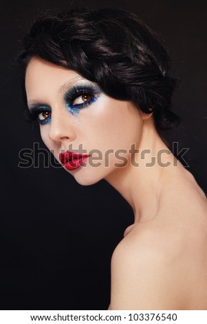 Young beautiful woman with fancy make-up and hairstyle - stock photo