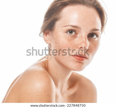 young beautiful woman with freckles portrait studio on white background - stock photo