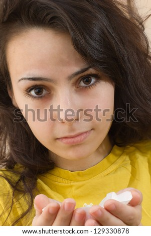 Young beautiful woman with fresh flower orchid
