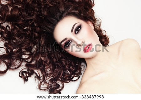 Young beautiful woman with fresh make-up and long curly hair - stock photo