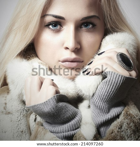 young beautiful woman with fur. winter style. close-up portrait of pretty girl. Beauty blond Model Girl in Mink Fur Coat.shellac manicure.pink lipstick.cosmetic make-up.lady.blue eyes - stock photo