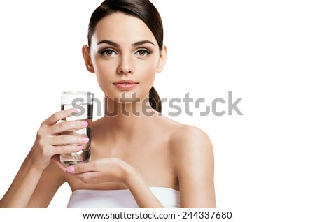 Young beautiful woman with glass of clear water, healthy life concept / photography of the European appearance girl holds a transparent glass of water - isolated on white background  - stock photo