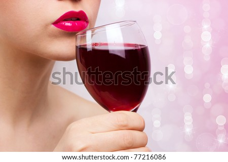 young beautiful woman with goblet of wine