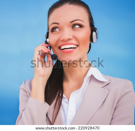 Young beautiful woman with headset isolated on blue background