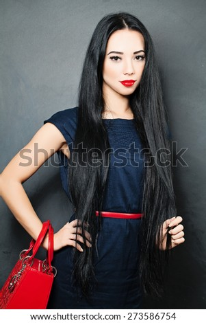 Young Beautiful Woman with Healthy Black Hair. Fashion photo - stock photo