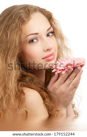 Young beautiful woman with healthy skin and flower in her hand in water. Isolated on white background - stock photo