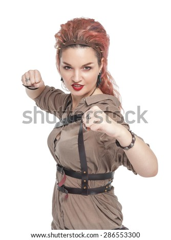 Young beautiful woman with her fists ready to fight isolated over white - stock photo