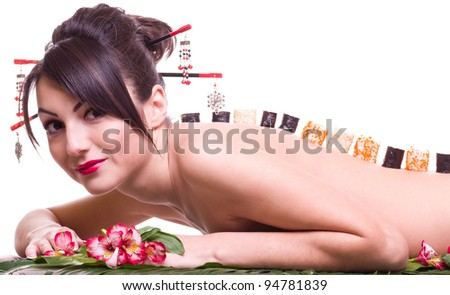 Young beautiful woman with Japanese sushi rolls, isolated on white background - stock photo