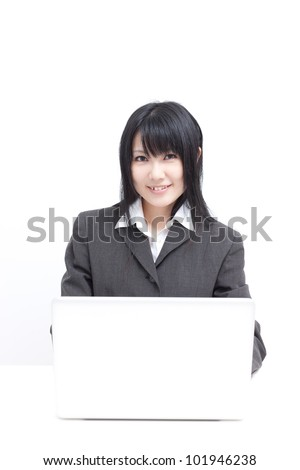 Young beautiful woman with laptop computer - stock photo