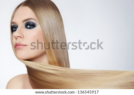 Young beautiful woman with long blond hair
