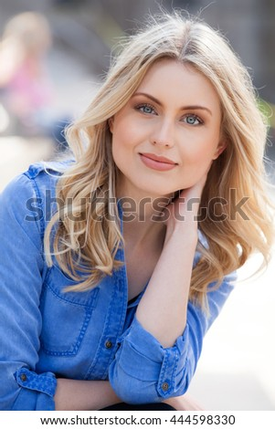 Young beautiful woman with long blond hair. - stock photo