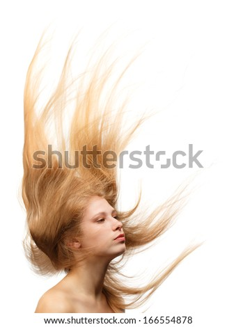 Young beautiful woman with long blond hair flowing like a flame isolated on white background - stock photo