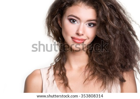 Young beautiful woman with long curly hair. Woman beauty portrait. Unruly hair