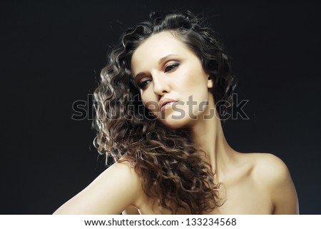 Young beautiful woman with long curly hairs - stock photo