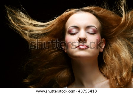 young beautiful woman with long hair - stock photo