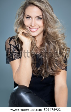 Hair highlights stock images royalty free images vectors young beautiful woman with long hair and highlights posing in black silk lace top smiling pmusecretfo Gallery
