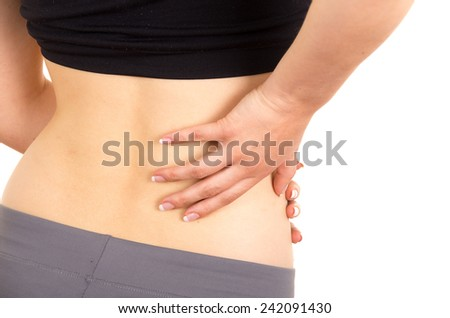 young beautiful woman with lower back pain isolated on white - stock photo