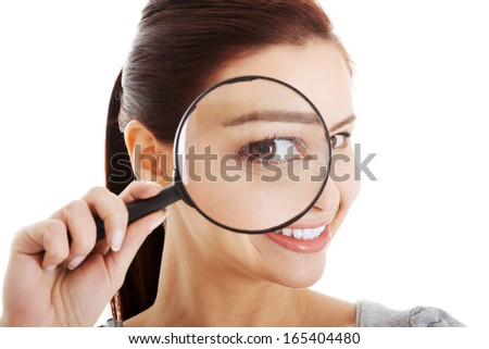 Young beautiful woman with magnifying glass.  Isolated on white.  - stock photo
