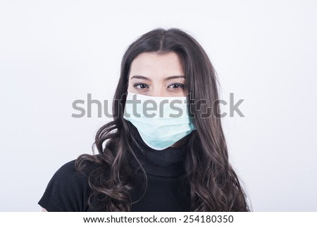 Young Beautiful Woman With Mask - stock photo