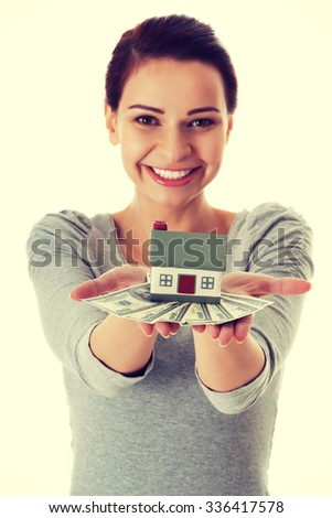 Young beautiful woman with money and house - stock photo