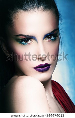 young beautiful woman with perfect make up, closeup face, studio
