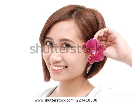 young beautiful woman with pink flower - stock photo
