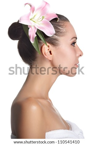 young beautiful woman with pink flower in a profile