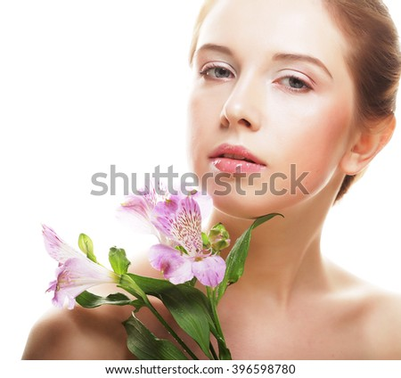 young beautiful woman with pink flower isolated on white - stock photo