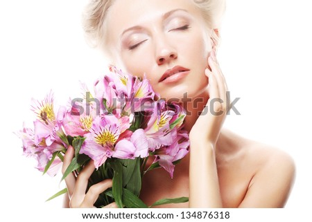 young beautiful woman with pink flowers - stock photo