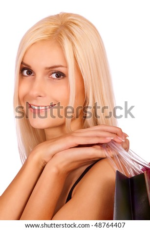 Young beautiful woman with purchases smiles, it is isolated on white background. - stock photo