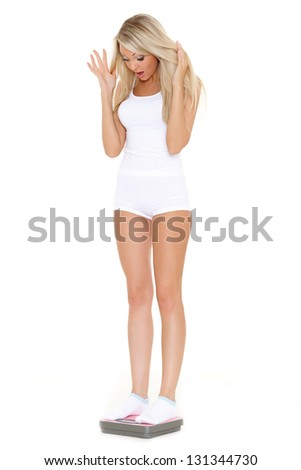 Young beautiful woman with scale on a white background.  Concept of healthy lifestyle. - stock photo