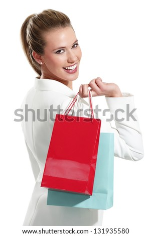 Young beautiful woman with shopping bag on white background - stock photo