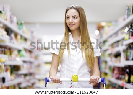 Young beautiful woman with shopping cart