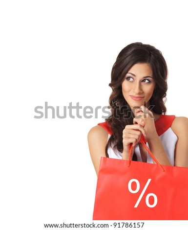 Young beautiful woman with some shopping bags isolated on white - stock photo