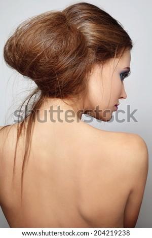 Young beautiful woman with stylish hair bun - stock photo