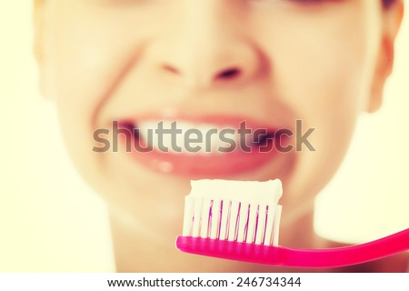 Young beautiful woman with toothbrush and paste. - stock photo