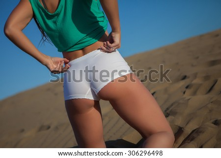 young beautiful woman with white bikini in beach - stock photo