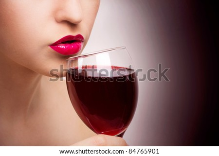 young beautiful woman with wine, close-up