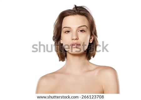 young beautiful woman without make-up on a white background - stock photo