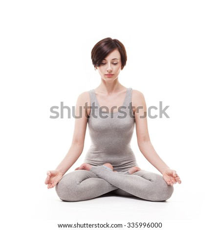 young beautiful woman yoga posing on isalated white studio background - stock photo